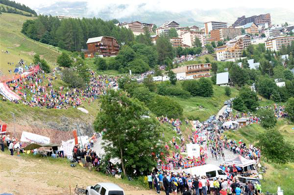 Riders approach the summit of L'Alpe d'Huez in stage 18 of the 2013 Tour de France