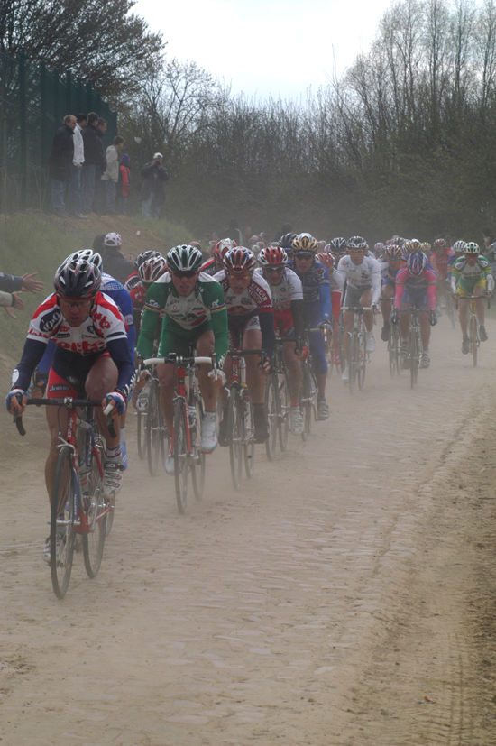 Riders raise dust over the cobbles