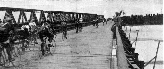 Riders crossing the Piave river