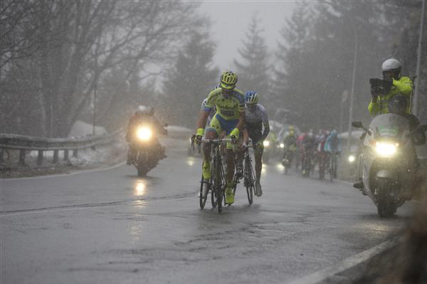 Alberto Contador climbs during the snowy stage