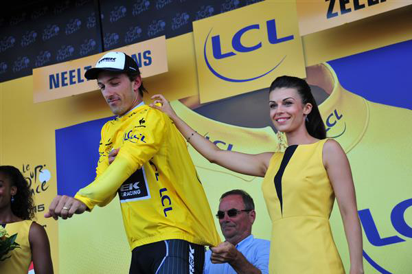 Bernard Hinault helps Fabian Cancellara with the yellow jersey